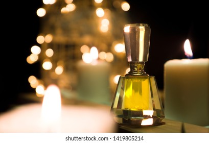 Arabian Oud Attar in the background of candles