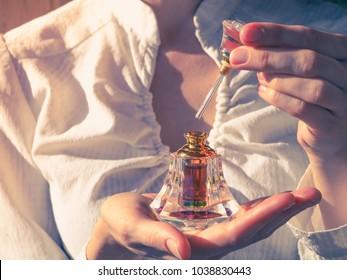 Arabian oud attar perfume or agarwood oil fragrances in crystal bottle.