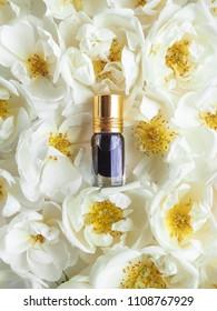 Arabian oudh attar perfume or agarwood oil fragrances with rose in mini bottle.