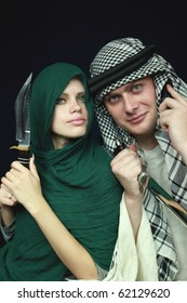 Arabian pair with sharp knifes and a mobile phone