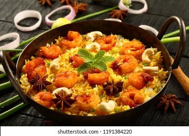 Arabian recipe- spicy seafood kabsa, biryani with shrimps and prawns