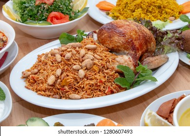 Arabian rice kabsa with chicken , food in middle east, Rice mixed with spices and herbs and chicken and salads
