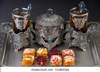 Arabian tea in a ornament cup with masghati sweets