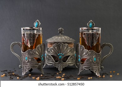Arabian tea in ornament glasses with brown sugar