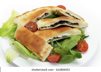 Arabian traditional spinach and labneh (cream cheese) fataya, a sort of Arab calzone, made from a flat-bread dough folded over the filling and baked in a traditonal pizza oven.