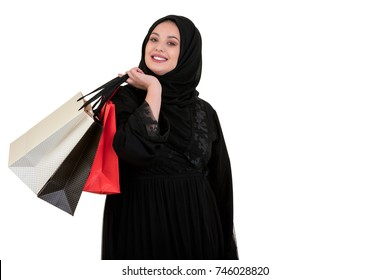 Arabian woman carrying shopping bags isolated on white