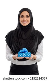 Arabian woman holding a gift box. Beautiful lady with feeling of joy and happiness. Half length portrait on white.
