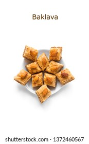 Arabic Baklava. Turkish Ramadan Dessert Baklava with almond nuts and honey isolated on white.