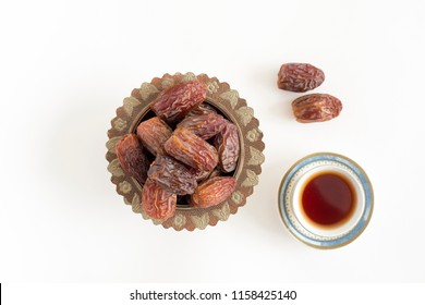 Arabic black Cofee and Fresh Dates on white isolated Backgorund Top view