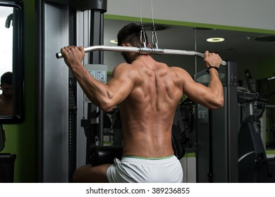Arabic Bodybuilder Doing Heavy Weight Exercise For Back On Machine