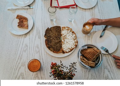 Arabic breakfast with za'atar and pita bread, drinking coffee, typical Jordanian, Lebanese and Syrian food