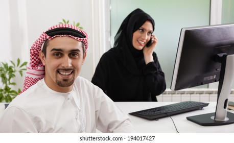 Arabic business couple working. Focus is on the man.