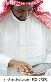 Arabic business man with tablet at office
