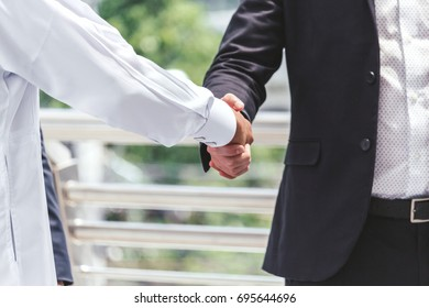 Arabic business people shaking hands