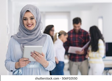 Arabic business woman working in team with her colleagues at office
