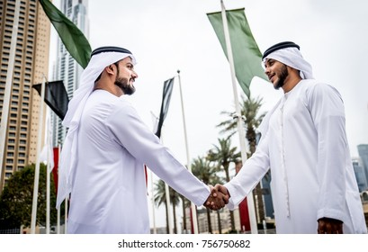 Arabic businessman giving an handshake to his business partner