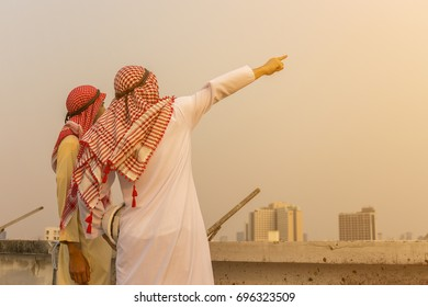 Arabic businessman meeting on construction site. ,Two businessmen standing and feeling happy,Success Concept