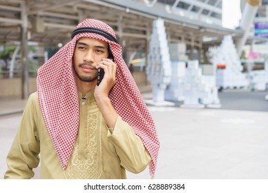Arabic Engineer Discussing Blueprint His Contractor Stock
