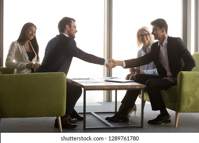 Arabic and caucasian male business partners handshaking at meeting greeting, making international partnership investment deal, diverse happy businessmen shaking hands as respect or gratitude concept