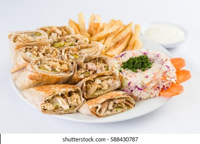 Arabic Chicken Shawerma with french fries and salad in Mediterranean Levantine Cuisine