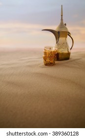 Arabic coffe pot on desert dunes