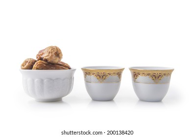 Arabic coffee cups with bowl full of dates