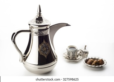 Arabic coffee pot with fresh dates