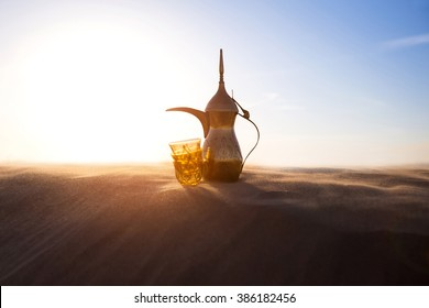 Arabic Coffee pot on desert dunes
