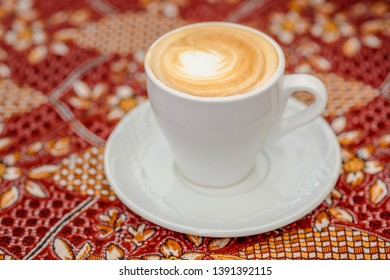 Arabic coffee. Side view latte or coffee or cappuccino.Turkish coffee on the traditional tablecloth.