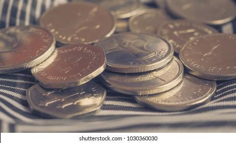 Arabic coins of dirhams. Toning.