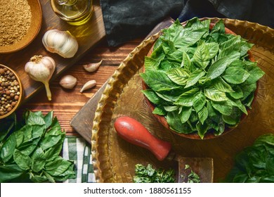 Arabic Cuisine; Egyptian organic jute leaves, Jew's mallow or (Molokhia). Those leaves are nutrient leafy greens full of phytonutrients that support heart health and immunity. Top view with close up. - Shutterstock ID 1880561155
