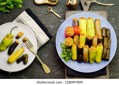 "Arabic cuisine; Egyptian traditional dish""Mahshy""or ""Dolma"". Stuffed Zucchini,eggplant,tomato,peppers and vine leaves.Top view for delicious stuffed vegetables."