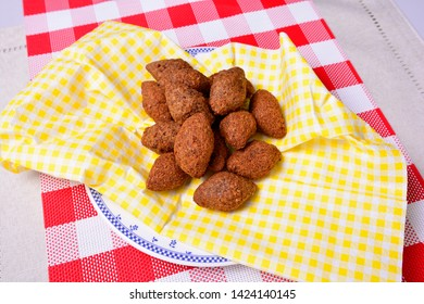 Arabic cuisine, Meat Appetizer Kibbeh on a plate, Brazilian Snack Kibe