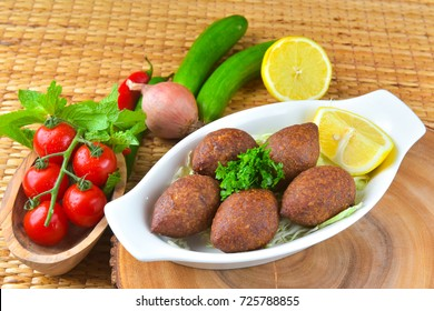 Arabic cuisine: meat appetizer kibbeh close-up on a plate - Arabic food