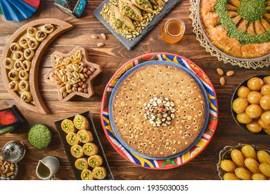 Arabic Cuisine: Middle Eastern desserts. Delicious collection of Ramadan traditional desserts. Served with tasty nuts, honey syrup and sugar syrup .Top view with close up. - Shutterstock ID 1935030035