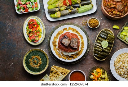 Arabic cuisine; Middle Eastern traditional lunch. It's also Ramadan 'Iftar'. The meal eaten by Muslims after sunset during Ramadan.Assorted of Egyptian  oriental dishes. Top view with copy space.