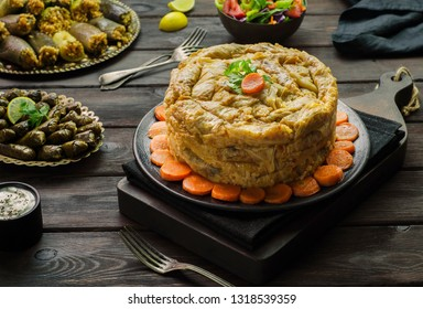 """Arabic cuisine; Middle eastern traditional """"Mahshy"""" or """"Dolma"""" dishes.Stuffed cabbage rolls, vine leaves, zucchini, eggplant and peppers. Served with green salad, fresh lemon and yogurt sauce."""