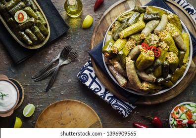 "Arabic Cuisine; Middle Eastern traditional dish ""Mahshy""or""Dolma"". Stuffed Zucchini, eggplant,tomato,peppers and vine leaves."