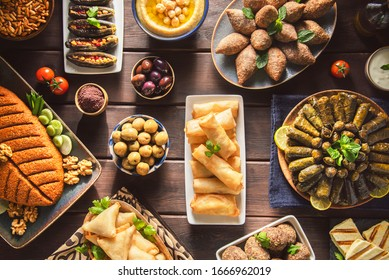 Arabic Cuisine;  Middle Eastern traditional dishes and assorted mezze or meze. Vine leaves, kibbeh, spring rolls, sambusak, kibbeh nayyeh, makdous, haloumi cheese, olives,hummus and yogurt salad.