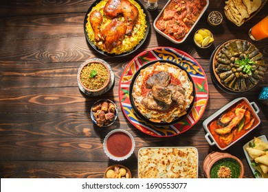 "Arabic Cuisine: Middle Eastern traditional lunch. It;s also Ramadan ""Iftar"" . The Meal eaten by Muslims after sunset during Ramadan. Assorted of Egyptian oriental dishes. Top view with copy space. - Shutterstock ID 1690553077"