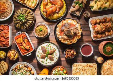 "Arabic Cuisine: Middle Eastern traditional lunch. It's also Ramadan ""Iftar"". The meal eaten by Muslims after sunset during Ramadan. Assorted of Arabic oriental dishes. top view with close up."
