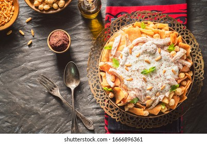"""Arabic Cuisine; Traditional Lebanese """"Chicken Fatteh"""" includes chickpeas,toasted pita bread and shredded chicken. Topped with warm garlicky yogurt sauce, fresh parsley and toasted pine nuts.  - Shutterstock ID 1666896361"""