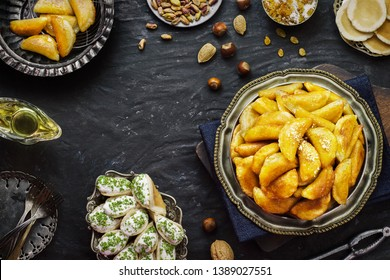 "Arabic Cuisine; Traditional Ramadan dessert ""Qatayef"" or Atayef"".Close up for delicious Ramadan dessert served with roasted nuts and honey syrup."