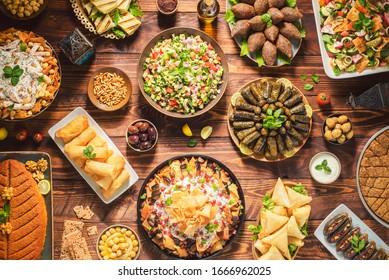 Arabic Cuisine;Middle Eastern traditional dishes and assorted meze. Vine leaves, kibbeh,chicken fatteh, spring rolls, sambusak, kibbeh nayyeh, makdous, haloumi, olives, eggplant fatteh and salads.
