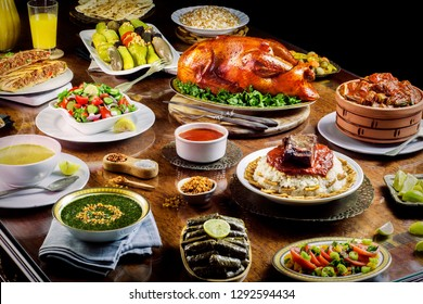 Arabic cuisine;Middle Eastern traditional lunch. It's also Ramadan 'Iftar'.The meal eaten by Muslims after sunset during Ramadan. Assorted of Egyptian oriental dishes.Served food for Family Gathering.