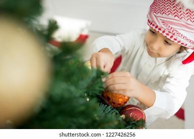 Arabic cute boy with new year tree