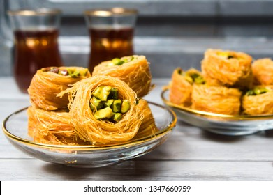 Arabic dessert with pistachio served with tea