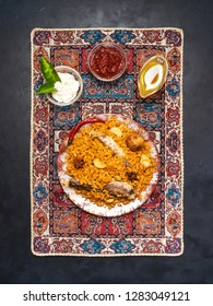 Arabic dish of rice and fried fish. Fish Kabsa.