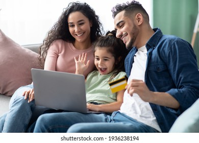 Arabic Family Of Three With Laptop And Credit Card Making Online Shopping