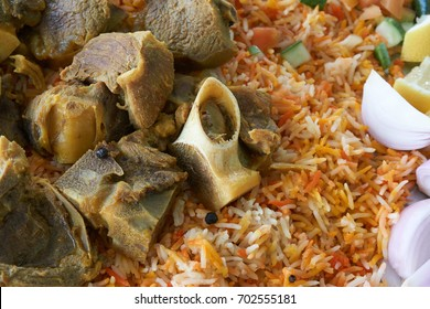 Arabic famous traditional food. Mandi rice with lamb, chicken, onion, lemon and green chillies.